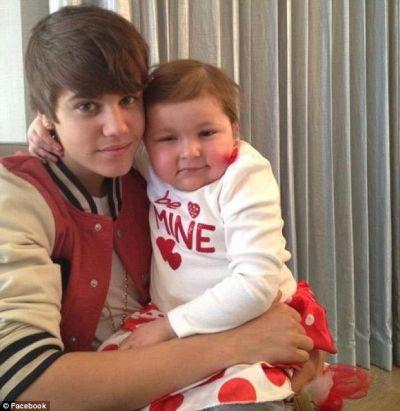 "Justin Bieber ""s-a casatorit"" cu o fetita blonava de cancer  – FOTO"